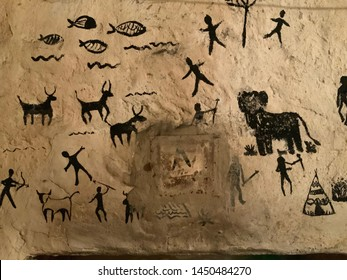 art in cave paintings on the stone wall. Prehistoric hunt painted in black