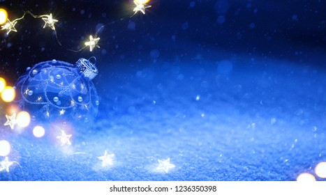 Art Christmas tree  light and holidays decoration on blue snow background