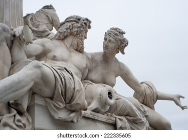 The art of conversation, depicted in classical form on a statue outside the Parliament Building in Vienna, Austria.