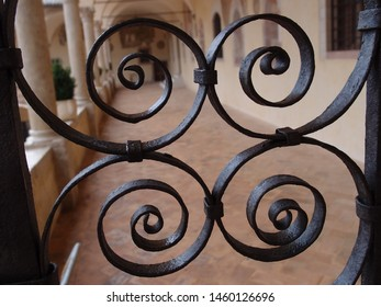 Art creation related to gate featuring curls black. The artistic domain is door, architecture.