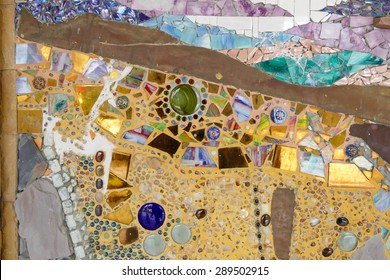 the art design of the colorful broken tile and stone decorating on temple wall for abstract background