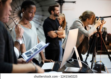 Art director checking the photos on a monitor