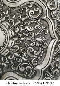 The art of embossing pattern onto a sheet of metal.