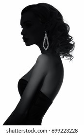 Art Fashion Contrast black and white photo of a woman with the earring. Jewelry for women. Light and shadows on the girl's body. Perfect figure blonde women