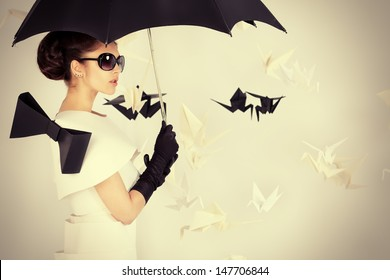 Art fashion photo of a gorgeous woman in paper dress. Black and white.