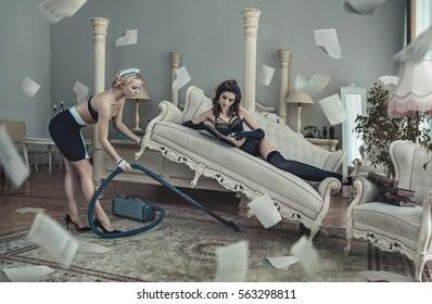 Art fashion scene - two attractive sexy women in bedroom