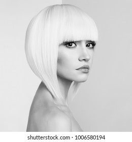 Art fashion studio portrait of beautiful blonde with short haircut