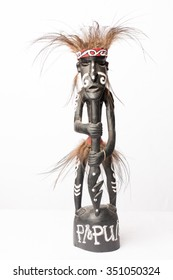 art figure from papua new guinea on white background