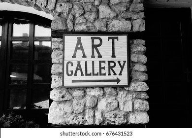 art gallery sign on the wall