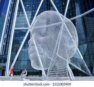 Art Installation known as Wonderland by Jaume Plensa, situated outside the Bow Building Plaza in Calgary, in the Province of Alberta. Sept 2019