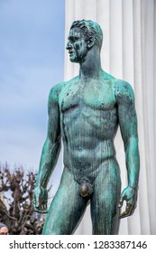 The art nouveau statue of handsome necked aryan man near Theseus Temple in Volksgarten park in Vienna. Winter in Austria, Europe.