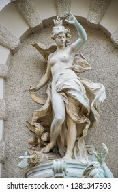 The art nouveau statue of nymph near Hofburg Imperial Palace in Vienna at Christmas time, Austria. Winter in Europe.