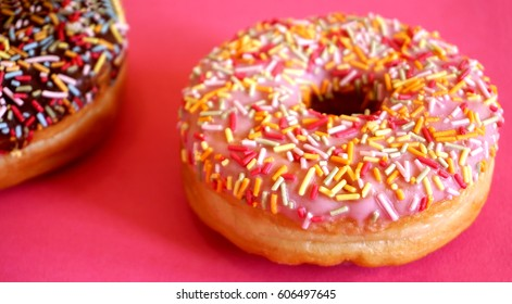 Art Nouveau style concept image, Iced doughnut / donut with sprinkles on a colorful background / multi colored geometric trendy background, food and healthy concept