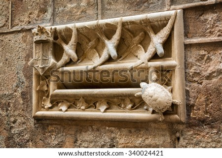 Art Nouveau Style Stone Mailbox Decorated With Swallows And Turtle  Figurines On The Wall Of Casa