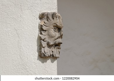 Art on the wall, beautiful stone sculpture on solid. Conceptual photography.