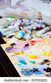 art paint palette with colorful paints, close up