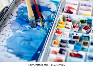 art painting inspiration creativity concept. mixed ink colors. watercolor palette and brushes. artist instruments.