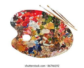 art palette with blobs of paint and a brush on white background