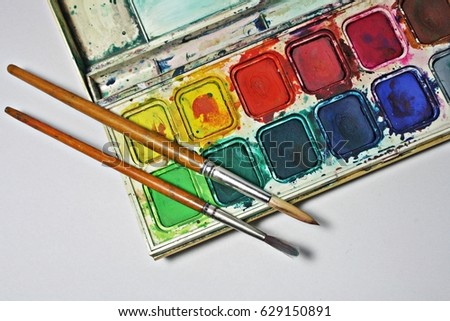 art palette with brushes paints