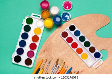 Art Palette with Colorful Paints Close Up top View
