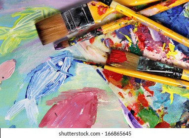 Art palette, picture and brushes with a lot of vivid colors