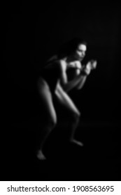 art photography, dancer expresses emotions through movement, body abstraction on black background