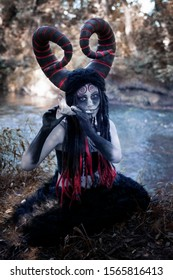 Art photography - a demon faun playing on the jawbone of an animal, on the banks of a dark river of time