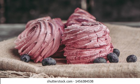 art photography of red berry marshmallow on fabric background