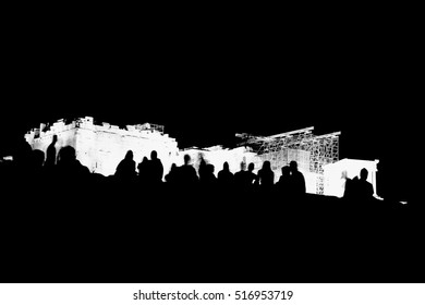 Art photo.Silhouettes of people on the background of the Parthenon.Extra black and white.High contrast.Athens,Greece.