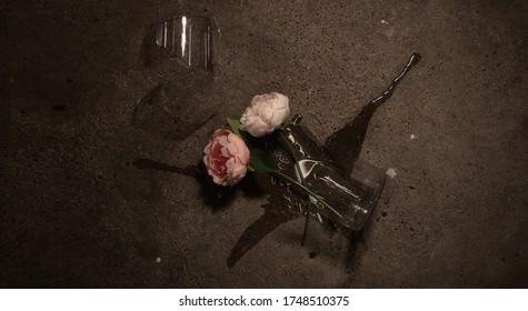 Art picture of a broken vase and peonies broken on a floor.