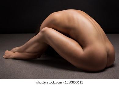 Art portrait of athletic slim woman body.