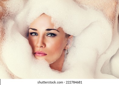 art portrait of a beautiful blond woman in the foam