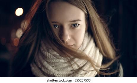 Art portrait of a beautiful girl. gorgeous brunette girl, portrait in night city lights.