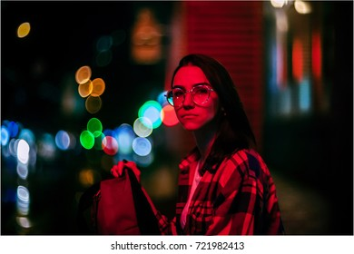 Art portrait of a beautiful girl. gorgeous brunette girl, portrait in night city lights. Vogue fashion style portrait of young pretty beautiful woman with dark hair. Girl portrait in night city lights