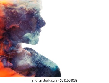 Art portrait. Female universe. Ice fire. Harmony balance. Double exposure glitter orange flames blue smoke in profile woman silhouette isolated on white copy space background.