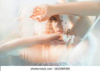 Art portrait. Feminine beauty. Double exposure blur sensual pensive woman silhouette with stained steamed glass holographic iridescent glow effect. Skincare wellness. Melancholy dream.