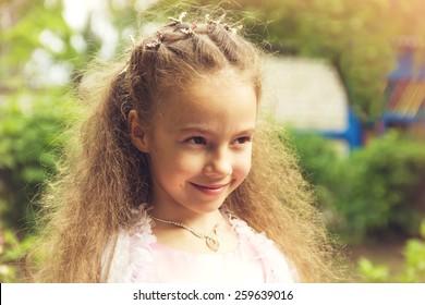 Art portrait of a pretty little girl wearing princess dress.Toned.