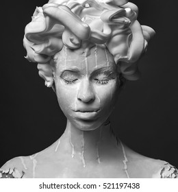 art portrait of woman with clay mask