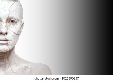 Art portrait of woman covered in clay over ombre white black background