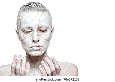 Art portrait of woman covered in clay over white background
