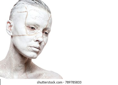 Art portrait of woman covered in clay