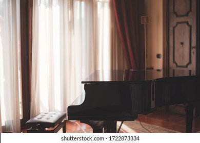 Art scene of a grand piano and beautiful sunlight radiating through the curtains of a room in nice moody style.
