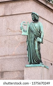Art and science, statue in the foot of the King Wilhelm column at Schlossplatz, Stuttgart