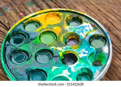 art still life - watercolor palette, jars with gouache