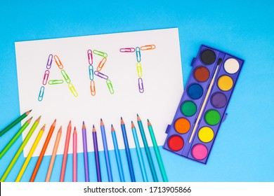 Art supplies for drawing and painting on blue background