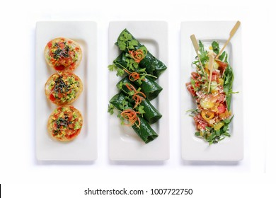 The Art of Tapas – Delicious set of tapas with an Asian twist isolated on white background at top view angle.
