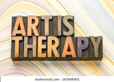 art is therapy word abstract in vintage letterpress wood type printing blocks against marbled paper