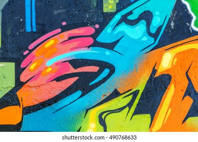 Art under ground. Beautiful street art graffiti style. The wall is decorated with abstract drawings house paint. Modern iconic urban culture of street youth. Abstract stylish picture on wall