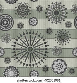 art vintage stylized geometric flowers seamless pattern, monochrome knitted background with light green, black and white colors