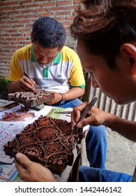 art workers when making stamp canting batik, made of copper with simple tools and manual patterns, in Pekalongan Indonesia 12 April 2017